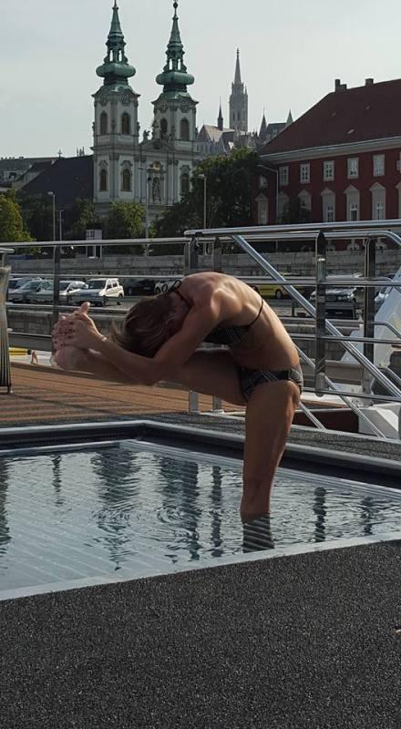 Missy Barrett Jones. Doing yoga. In a pool. On a boat.  Somewhere in Europe.